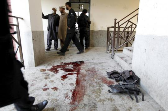 Blood stains and flak jackets used by attackers remain in the hallway of a dormitory where a militant attack took place, at Bacha Khan University in Charsadda